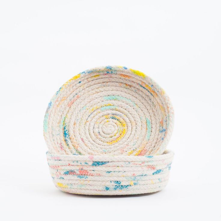 #DIY Inspiration // Splatter Painted/Dyed Rope Coil Basket - also very simple to make & probably less than $5-10 total & you can do custom colors -   A beautiful handmade basket by Gemma Patford which has been hand painted,  hand cut, hand craftedwith fluid rope handle using colouredpaint detail  All items are hand made in Melbourne. Each item is different, no two items  are the same.