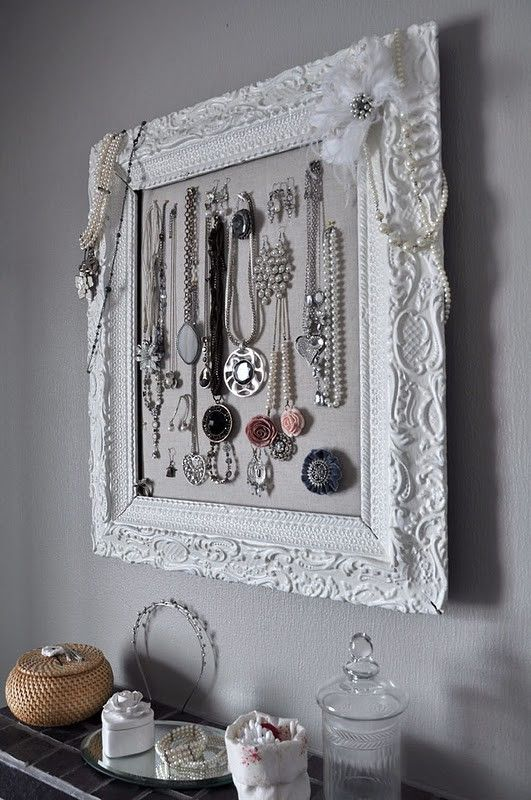 spray paint an old frame to beautifully organize jewelry
