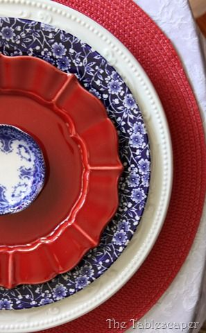 Red, white, and blue plates. I pinned this because it looks like someone beautifully combined their grandma's tiny antique blue plate, with everyday china (and undoubtedly something from Home Goods or Dollar Store)! Reminds me to look for ways to use pieces from my grandmother, even where I don't have a whole set.
