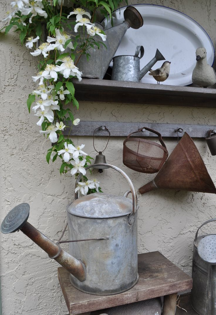 Watering can and other garden implements