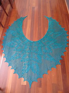 This is an almost circular crescent shawl that is knit for the top down.
