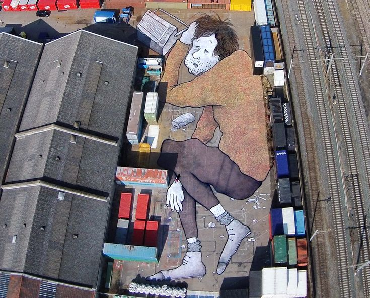 A giant street art in Lyon, France. These containers look like books