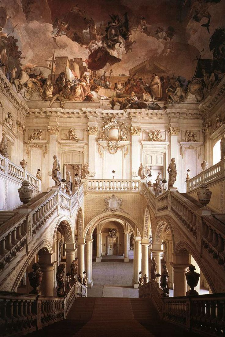 Grand staircase in the Würzburg Residence a Baroque-style palace in southern Germany. Venetian painter Giovanni Battista Tiepolo decorated the vault with a fresco showing paintings representing four continents: Europe America Asia and Africa. [764  1146]