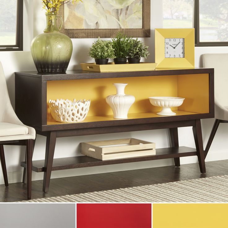 This retro-style console table offers a display or storage opening and lower storage shelf. It is the perfect piece to use to display personal belongings with a unique look and flair.