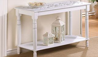 Carved top Table. A must-have for the romantic heart. Turned legs and an intricately carved top add rich visual appeal to this enchanting white wood table.