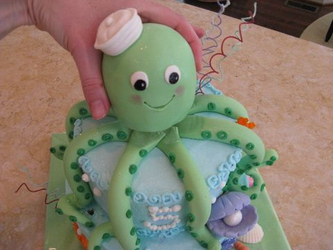 Octopus cake how to: this looks exactly like pipers favorite toy! Just change octopus to blue Nd cake pink! Love it!