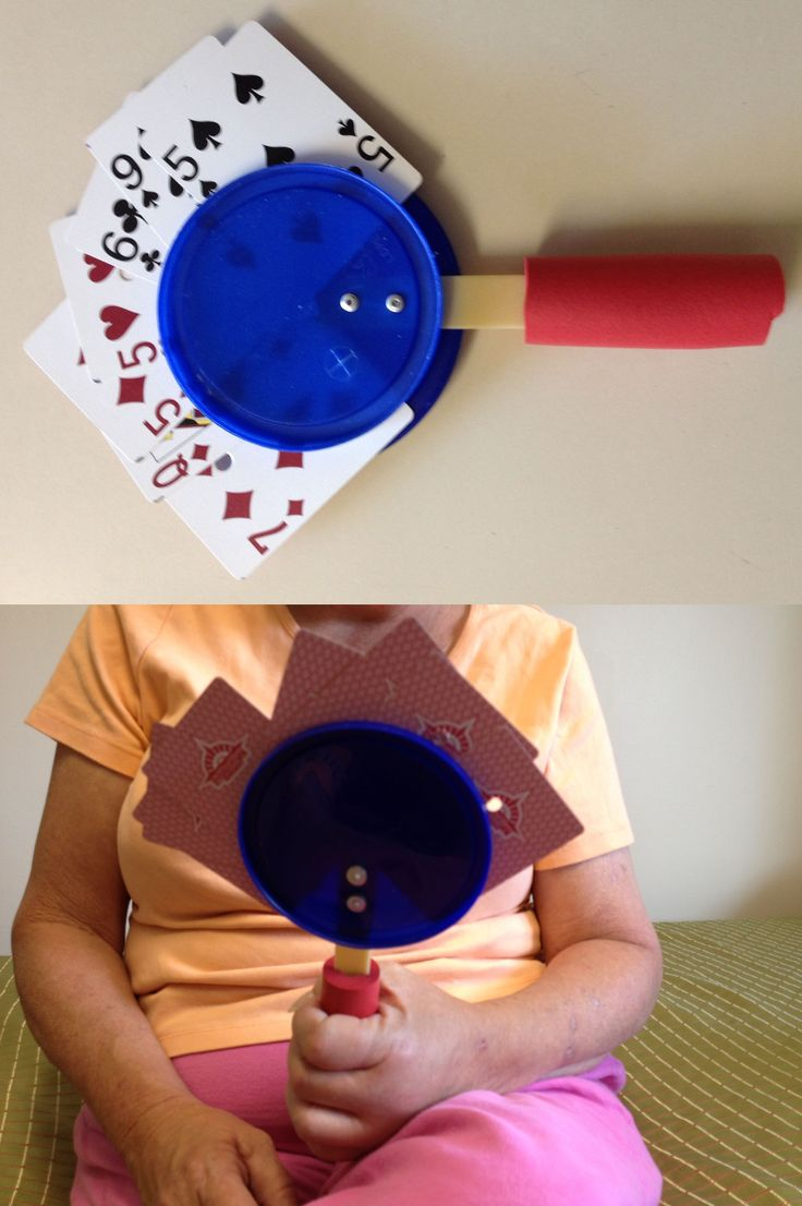 Card holder made with two lids riveted to a plastic tongue depresser which is built up with cylindrical foam - Outreach Therapy Consultants