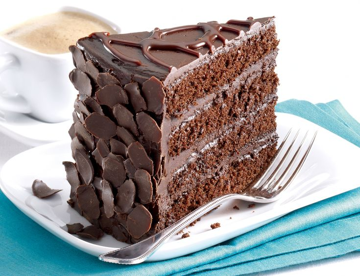 Chocolate Button Cake With 4 Layers Of Chocolate Icing In The Middle With 5 Layers Of Sponge
