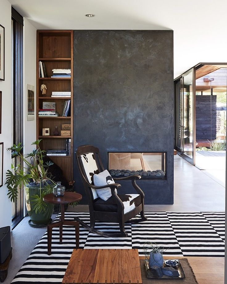 """More from the new Greener Grass story on Dwell.com. """"A rocking chair that once belonged to Debs grandmother sits next to the plaster fireplace in the living room; concrete floors were poured on-site. Photo: Christopher Testani Architect: mw/worksMore from the new Greener Grass story on Dwell.com. """"A rocking chair that once belonged to Debs grandmother sits next to the plaster fireplace in the living room; concrete floors were poured on-site. Photo: Christopher Testani @christophertestani…"""