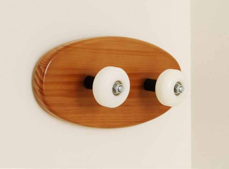 Coat rack with skateboard accessory for skateboarders