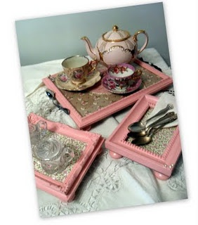 Trays made from old picture frames, with old silverware screwed on for handles  i saw this..they lined them with old rose fabric and used the smaller sized crystal door pulls for the feet!  So Pretty!  (i have a pale yellow one that is actually an old drawer with dividers for silverware)  use it at spring get togethers