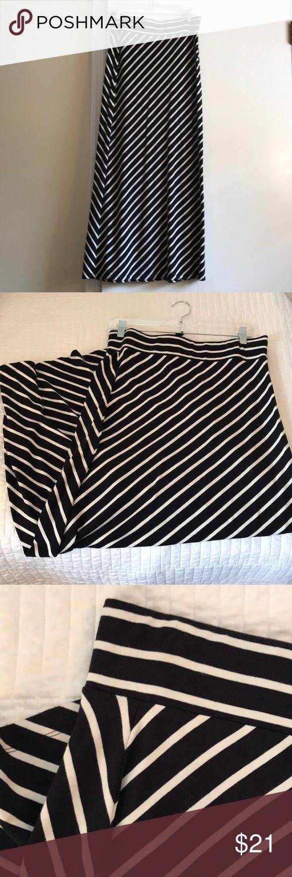 Ann Taylor Navy and Cream striped Maxi skirt Ann Taylor petites cotton Maxi skirt. Diagonal cream stripes. 93% Rayon 7% spandex. Ann Taylor Skirts Maxi