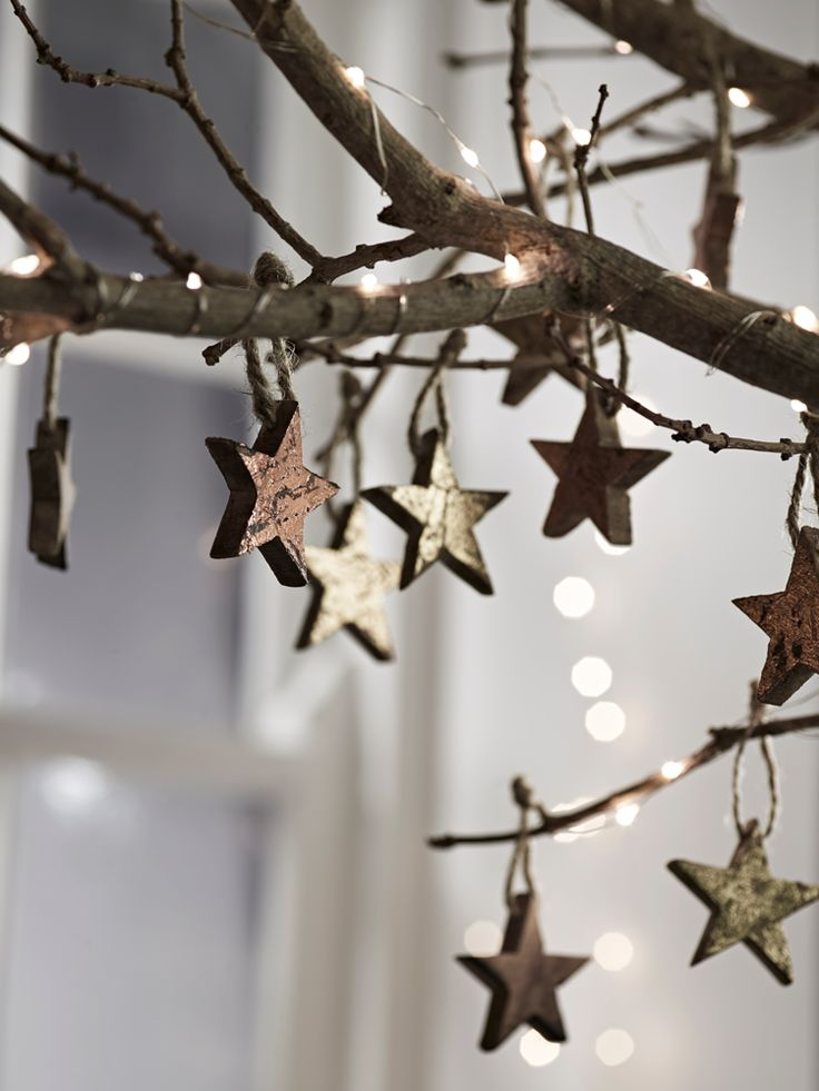Perfect for adding a subtle glimmer to your Christmas tree, our set of twelve wooden decorations consists of four pieces with a distressed gold leaf effect, four with a copper leaf effect and four with a natural wood finish. Each star has a unique finish, and is hung on a jute string.