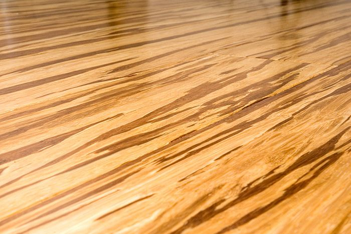Gorgeous! - Tiger strand-woven bamboo floors are made when the parings of two kinds of bamboo floors – natural and carbonized – are literally woven together and pressed into a new type of bamboo floor.