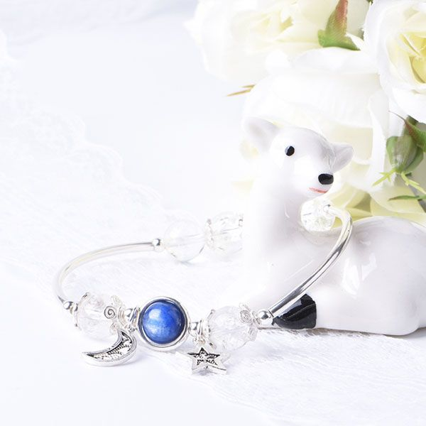 Show her she's the center of your universe with this celestial bracelet. It showcases a beautiful blue kyanite crystal planet with a silver moon and star dangler. A wonderful handcrafted gift for any occasion!