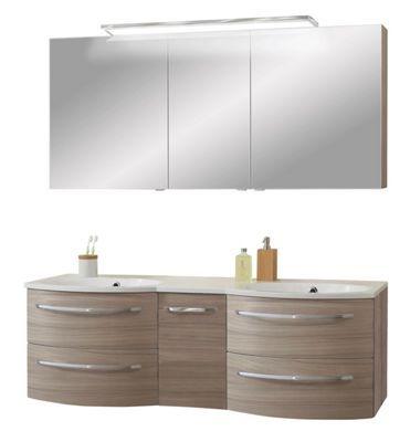 """Mit dem Badezimmer """"Cosmo"""" können Sie sich auf die morgendliche Routine freuen. Die Kombination aus Doppelwaschtisch und Spiegelschrank sorgt für ein angenehmes Ambiente. Dank der 2 Waschbecken ist die Einrichtung für die ganze Familie geeignet. Der praktische Schrank ist mit 3 verspiegelten Türen versehen. Dank des Steckdosenelements können Sie Rasierer, Zahnbürste oder Lockenstab direkt verwenden. Mit dem integrierten Schalter bringen Sie die Beleuchtung zum strahlen. Der Unterschrank…"""
