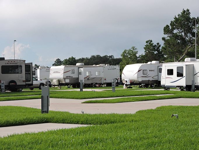 Bayou Bend RV Resort at Baytown, TX - 118 total sites, accommodates RVs up to 45', 20/30/50 amp service, 100 amp service at some sites, full hookups, sewer, water, Wi-Fi, cable TV, restrooms, showers, laundry facility, handicap access, ice, BBQ, picnic area, playground, pool, rental accommodations/cabins. Area Attractions: Royal Purple Raceway, Pirates Bay Water Park, and a short distance to Houston, Kemah, Boardwalk, and Galveston.