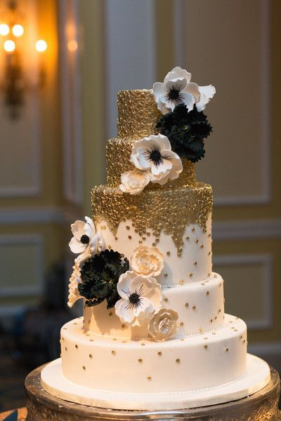 White, metallic gold and black wedding cake idea - five-tiered fondant-frosted cake with cascading flowers + gold accents {Photography by Marirosa}