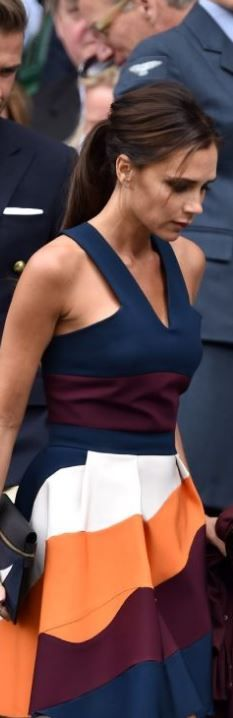 victoria beckham  Who made Victoria Beckhams orange stripe dress and blue clutch handbag?
