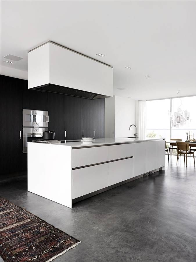 ..without the rangehood.. White kitchen, grey polished concrete floor..