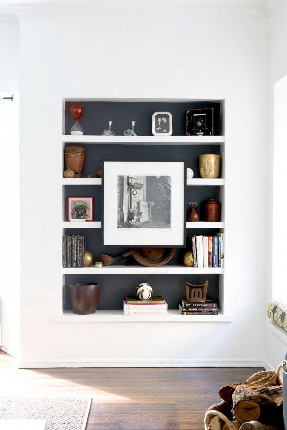 Love this spin on bookshelf styling! Add art!   Home Tour: A Santa Monica Traditional With a Modern Design via @domainehome