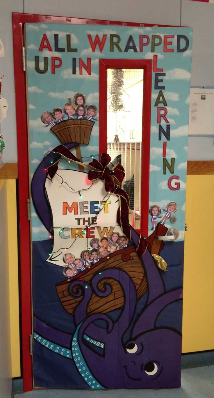 "Nautical, ship, ocean themed door/bulletin board ""All wrapped up in learning"" on the door, ""Meet the crew"" on the said - octopus wrapping a bow around the ship and lights added (Christmas time)"