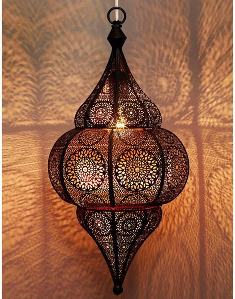 antique Middle Eastern lantern of hand-pierced metal