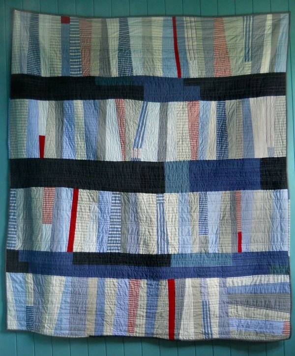 """""""A Touch of the Bends"""" Quilt.     Upcypled shirts, improv pieced & much inspired by the quilts of Gee's Bend. Solid strips of linen (my old gardening overalls) & other scraps. Backed with a stripey cotton sheet.   Quilted on the  machine with relaxed lines &  some (rustic) hand quilting thrown in on the solid strips using Perle cotton.    Finished size approx 65 """" x 75 """""""