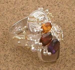 Konstsmycken, Hänge, Ringar, Örhängen, Armband, Halsband, Ametist, Granat http://www.designerartjewellery.com/svensk.htm