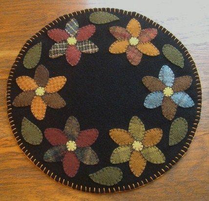 Penny Rug http://www.ebay.com/itm/Primitive-Wool-Penny-Rug-Jar-Candle-Mat-Pinwheel-Flowers-Handmade-/190647045361?pt=Folk_Art&hash=item2c63730cf1