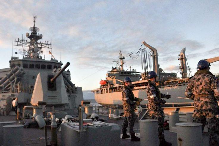 Royal Australian Navy Sailors man the distance line during HMAS Ballarat's Replenishment at Sea with HMAS Sirius. (photo: ABEW Andrew Hardrin)