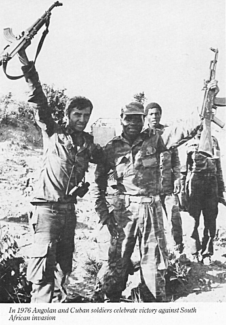 Cuban and Angolan troops celebrate victory against South African forces in 1976.