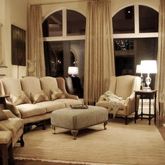 Like the idea of long drapes to cover the large windows...