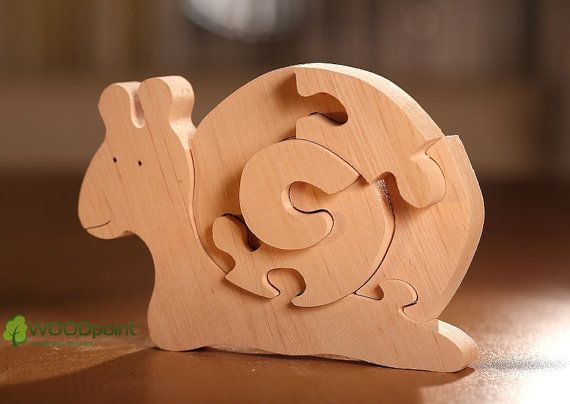 Wooden 3D animal puzzle Snail not only develops the logic, imagination and motor skills of the child (and parents too), but also is a stylish decoration of the children's room as well as an element of role-playing games.    Find more wooden handmade toys, puzzles, waldorf educational toys, wooden teethers and rattles on https://www.etsy.com/shop/woodpoint