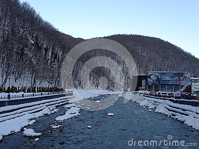 Winter river and new concert hall at ski resort Rosa Khutor, Russia
