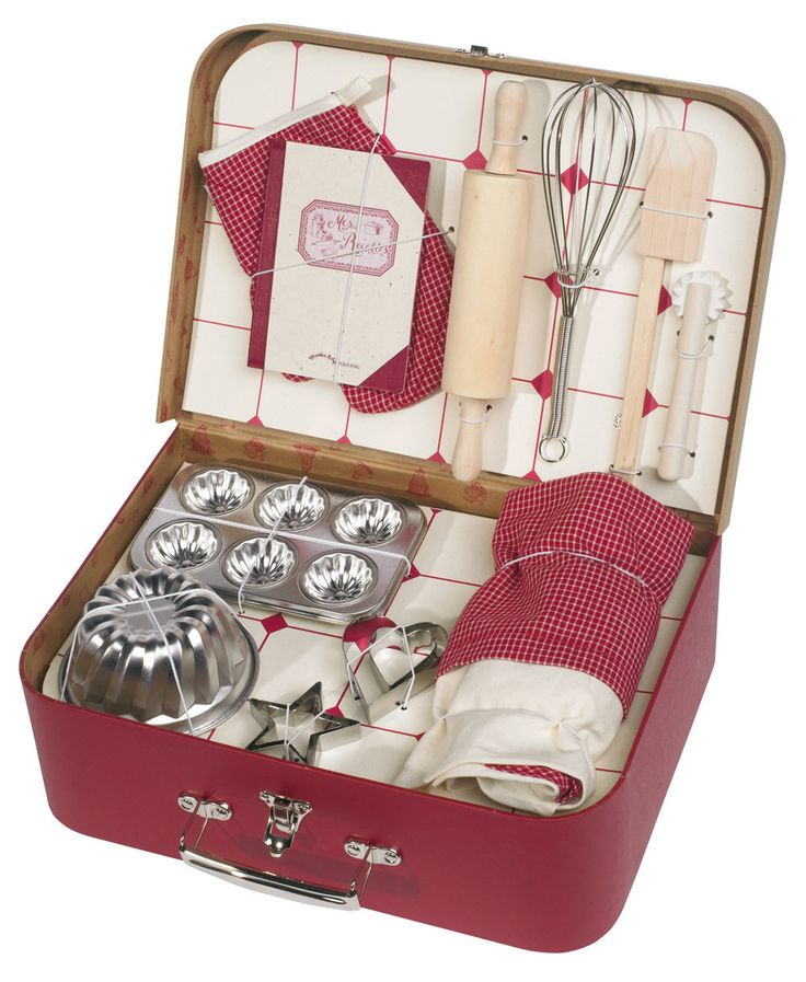 Moulin Roty Baking Set (includes apron, oven mitt, rolling pin, cookie cutters, pastry wheel, whisk, spatula, cookbook and cake tins), $84; bonjourpetit.com