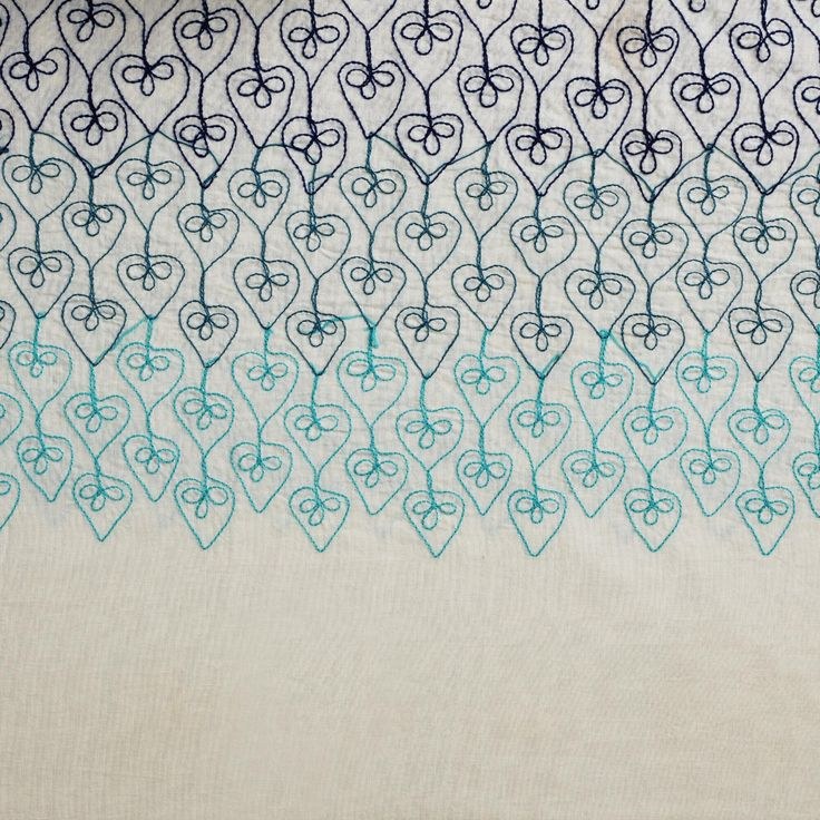 Featuring an embroidered Indian-inspired ombre design, our shower curtain boasts oceanic tonal blues that gradually go from dark to light blue on an ivory background.