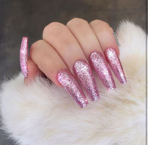 Long pink glitter stiletto nails