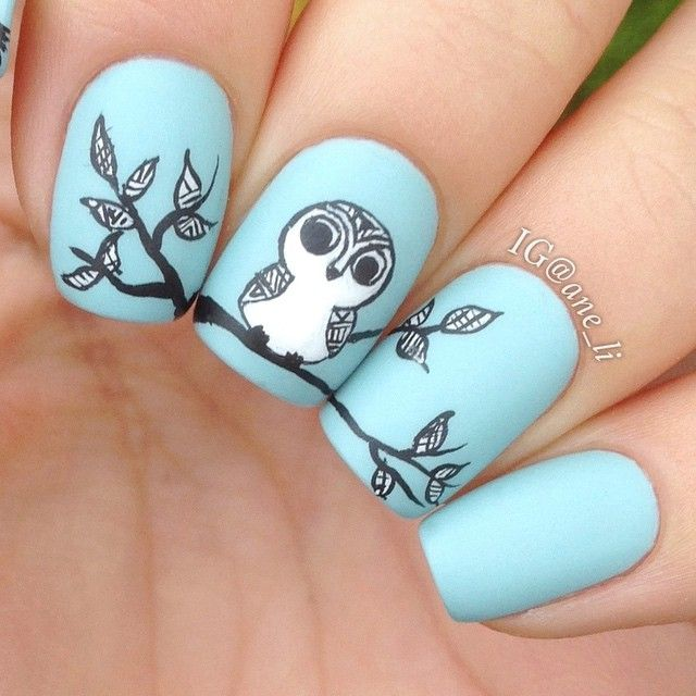 Pastel Blue, Black, and White Nails With Tribal Style Owl Art
