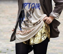 gold sequin shorts with opaque tights and graphic tee and cardigan