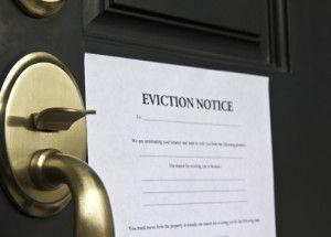 Eviction notice letter posted on front door of house