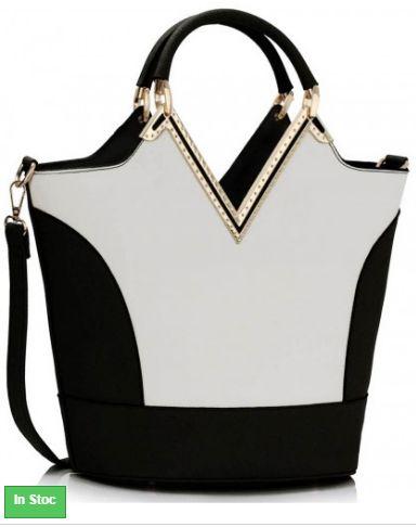 Geanta Dama Eleganta Black&White Jane geanta de dama, in nuante de alb si negru, cu manere duble, curea lunga, detasabila si buzunare interioare cu fermoar.