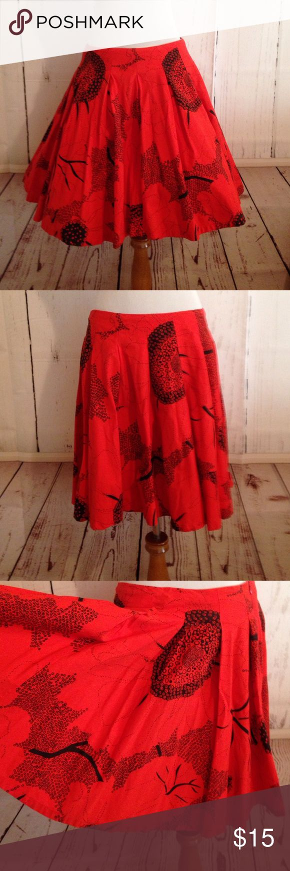 """Red and Black French Connection Circle Skirt size8 French Connection size 8 red floral print pleat skirt. Side zipper. 100% Cotton.  Waist 29"""" length 20"""". In good used condition some fading but still bright. First picture has a crinoline under skirt that is not included. French Connection Skirts Circle & Skater"""
