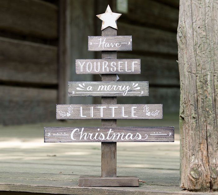 "Natural wood slat Christmas tree décor with hand-painted white distressed star and ""Have yourself a Merry little Christmas"" message. 18""H X 12 3/4""W X 3 1/2""D"