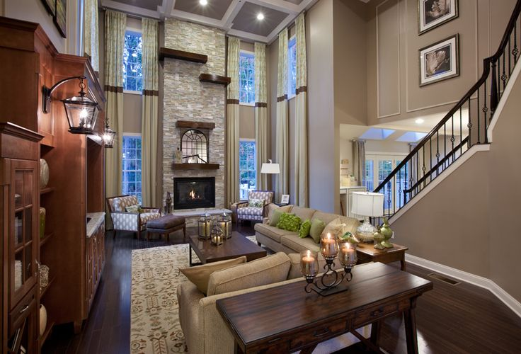 Chapel Hill at Sparta  tall fireplace open loft style living room design with lots of windows