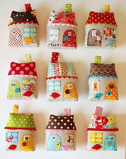 Houses made from fabric, ribbons and buttons