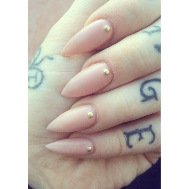 Matte nude stiletto nails with gold gems.✨