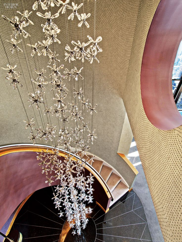 The stairwell features a custom crystal chandelier. Photography by Eric Laignel.