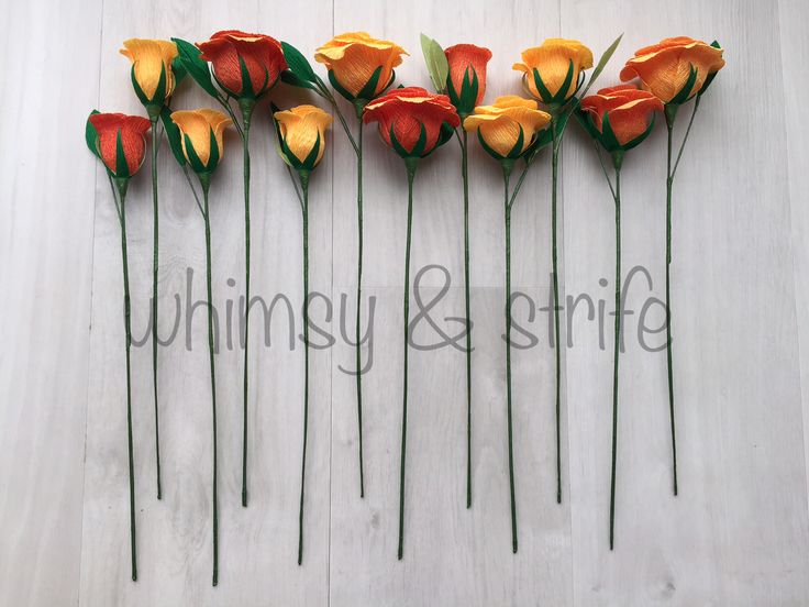 12 roses in orange gradient all with leaves. Made with crepe paper and fully wired.