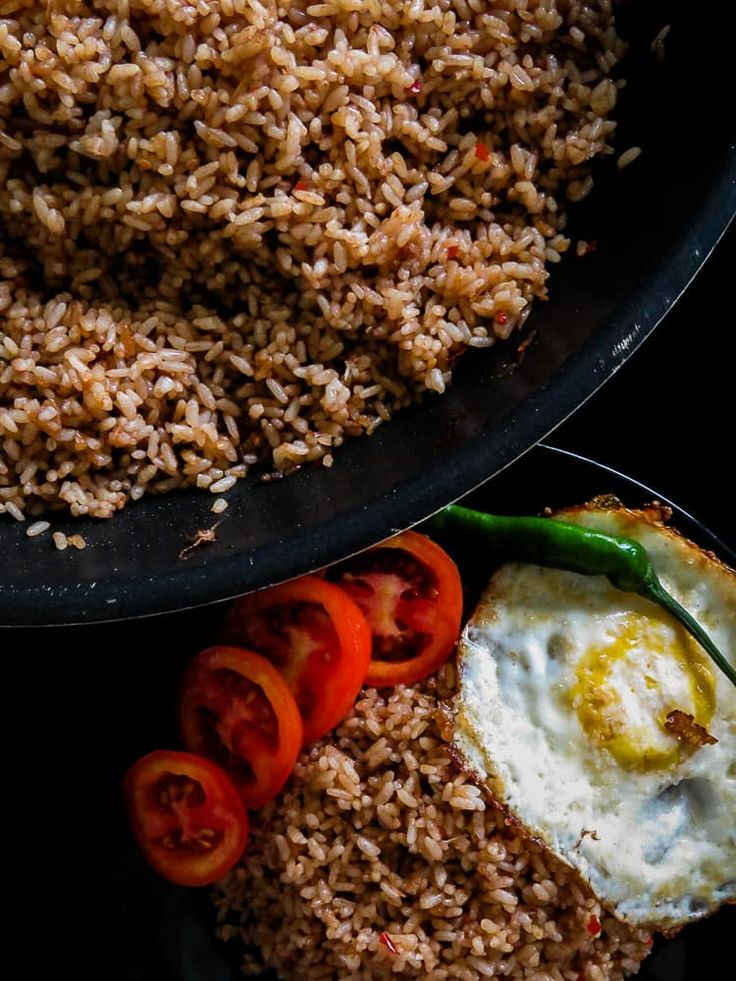 Learn to make this basic Indonesian Nasi Goreng recipe(fried rice). Add a mix of your favorite meat or seafood and you have a restaurant worthy dish.